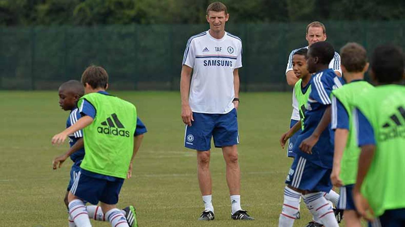 Former Chelsea striker Tore Andre Flo coaching