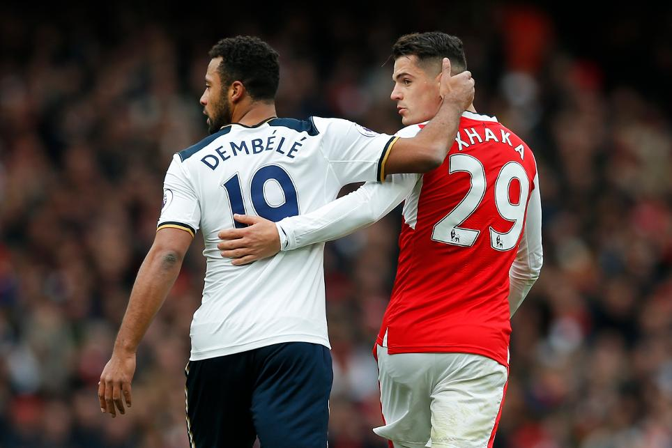 Arsenal's Granit Xhaka with Tottenham's Mousa Dembele