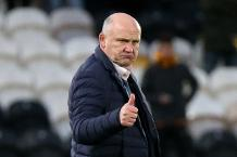 Hull City manager Mike Phelan celebrates after the game