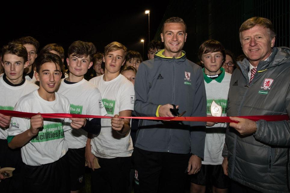 Ben Gibson cuts ribbon.JPG