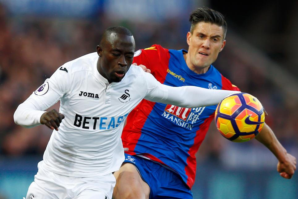 Crystal Palace's Martin Kelly in action with Swansea City's Modou Barrow
