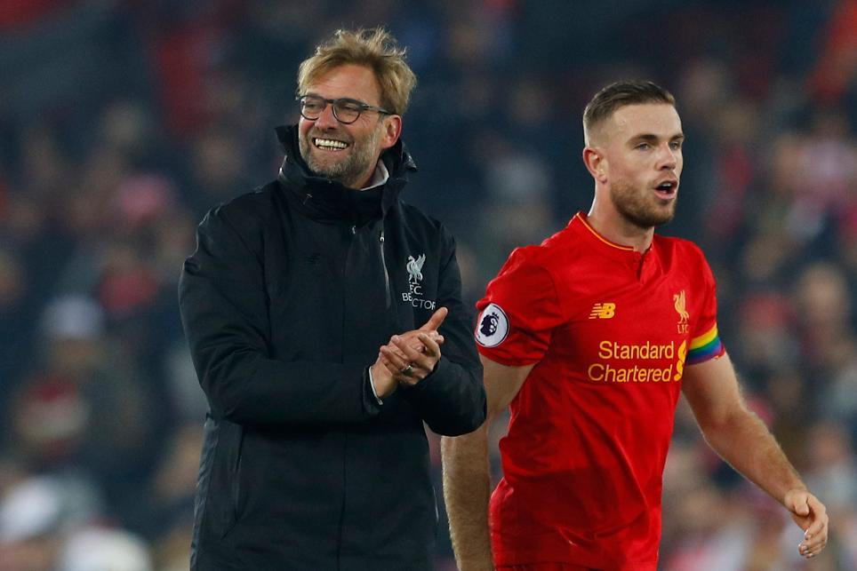Liverpool manager Juergen Klopp celebrates with Jordan Henderson at the end of the match