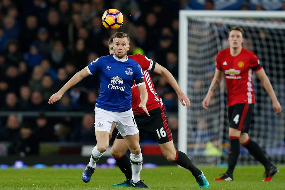 Everton's Tom Cleverley in action with Manchester United's Michael Carrick