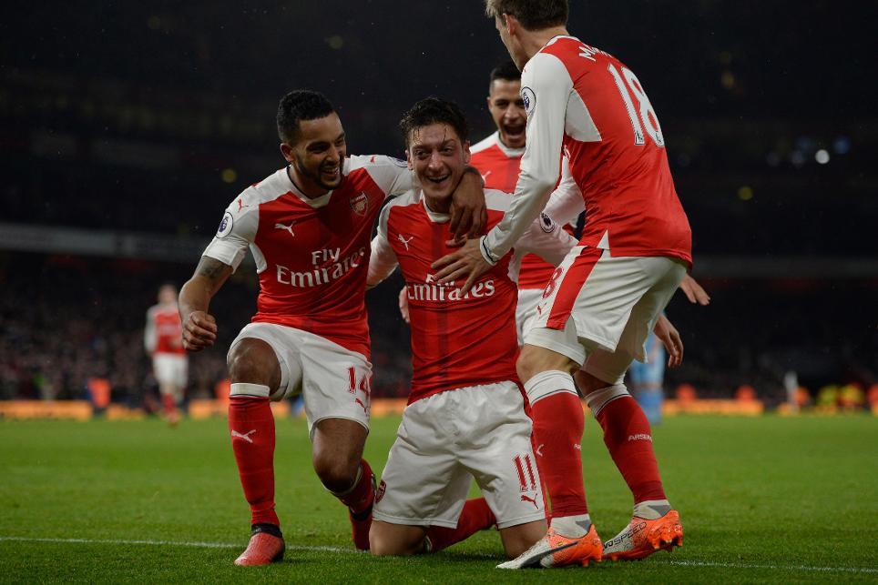 Arsenal's Mesut Ozil celebrates scoring their second goal with Theo Walcott and Nacho Monreal