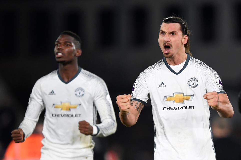 Manchester United's Zlatan Ibrahimovic celebrates after the match with Paul Pogba