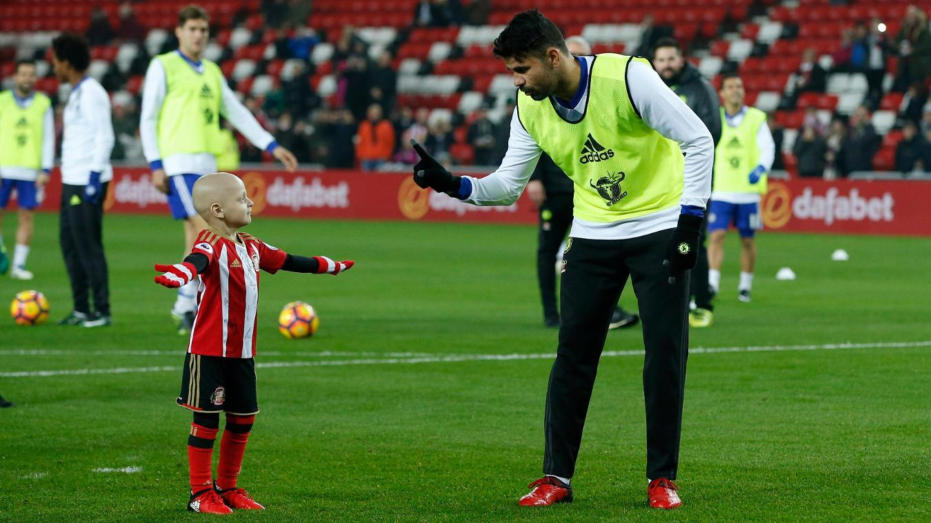 Chelsea's Diego Costa with Sunderland mascot Bradley Lowery