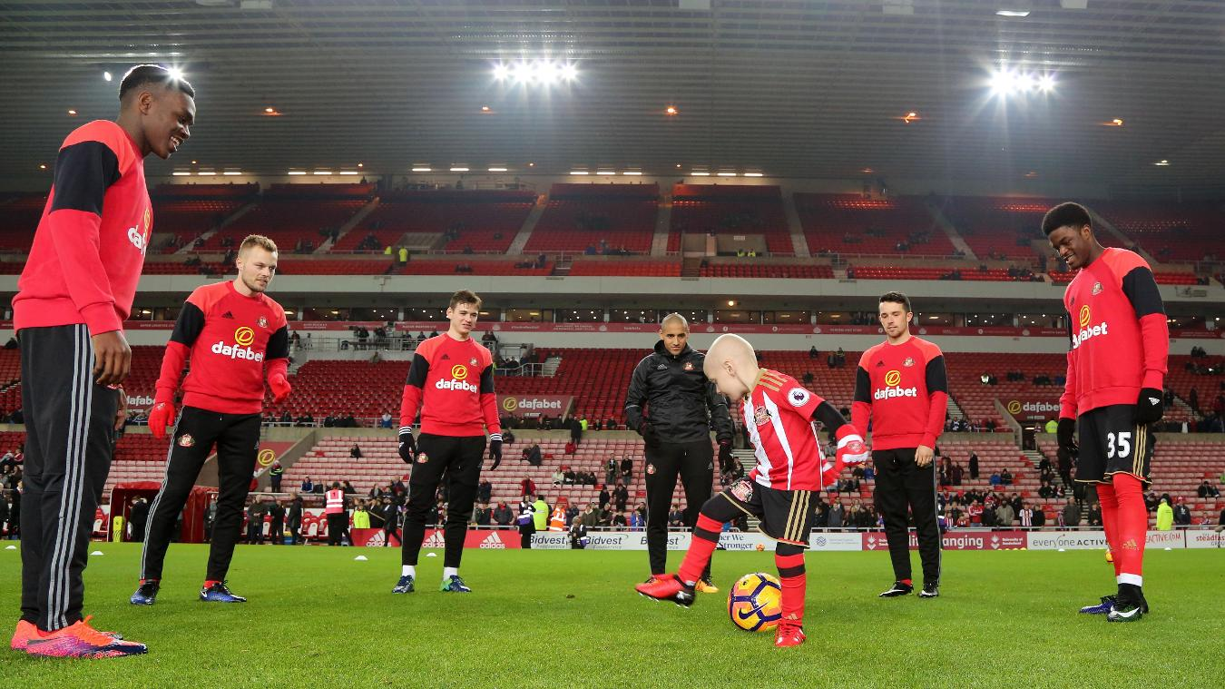 Bradley Lowery warms up with the Sunderland players