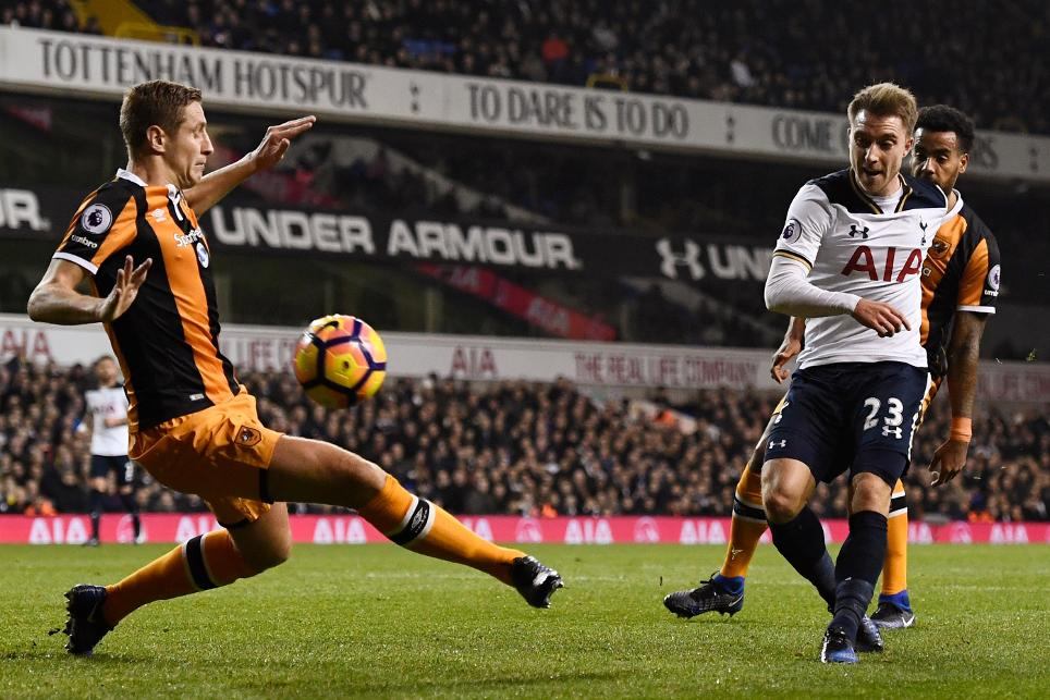 Tottenham's Christian Eriksen scores their first goal against Hull