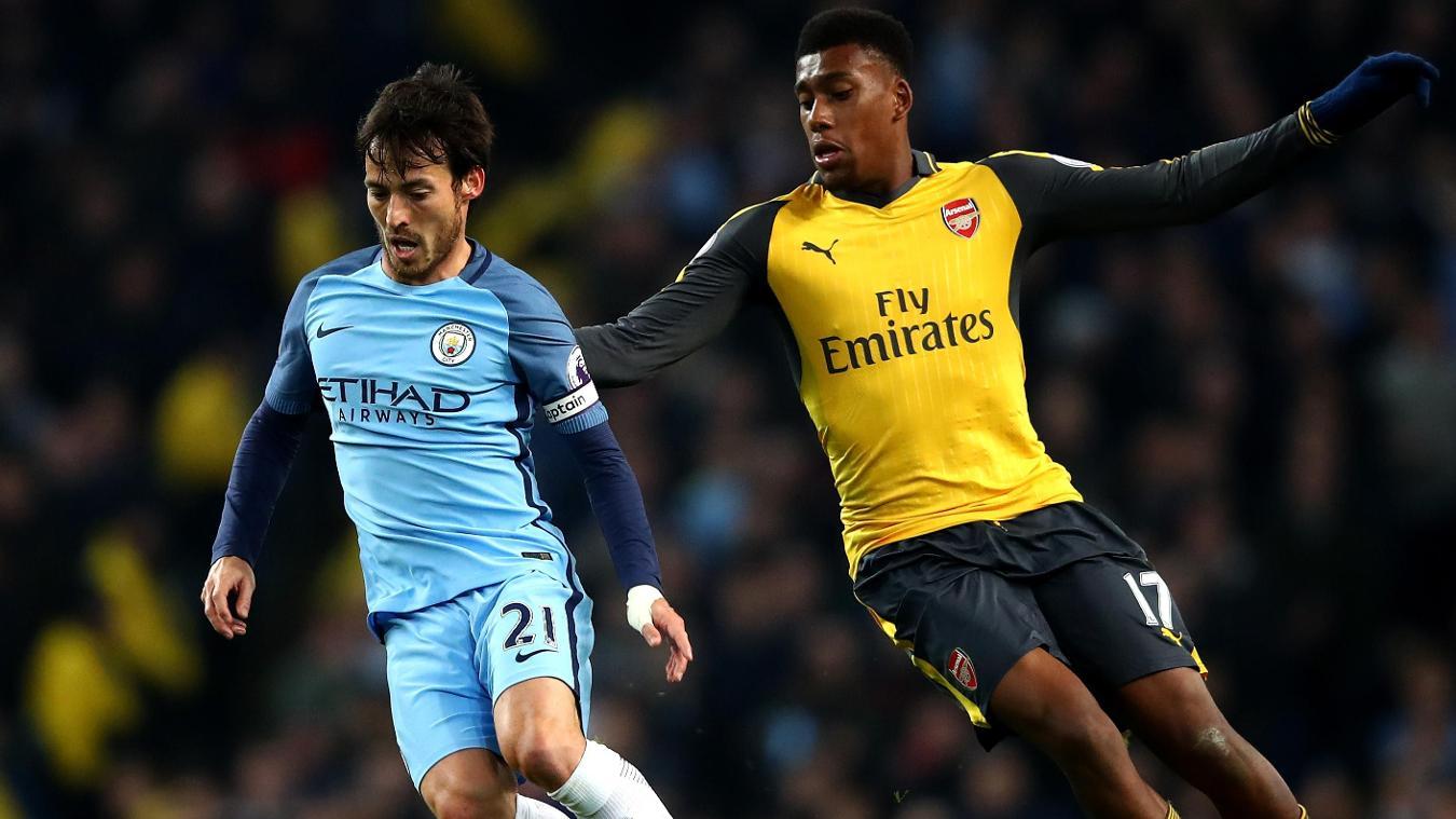 David Silva of Manchester City, left, and Arsenal's Alex Iwobi