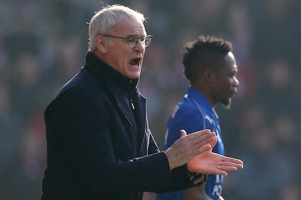 Leicester City's Ahmed Musa waits to come on as substitute as manager Claudio Ranieri looks on