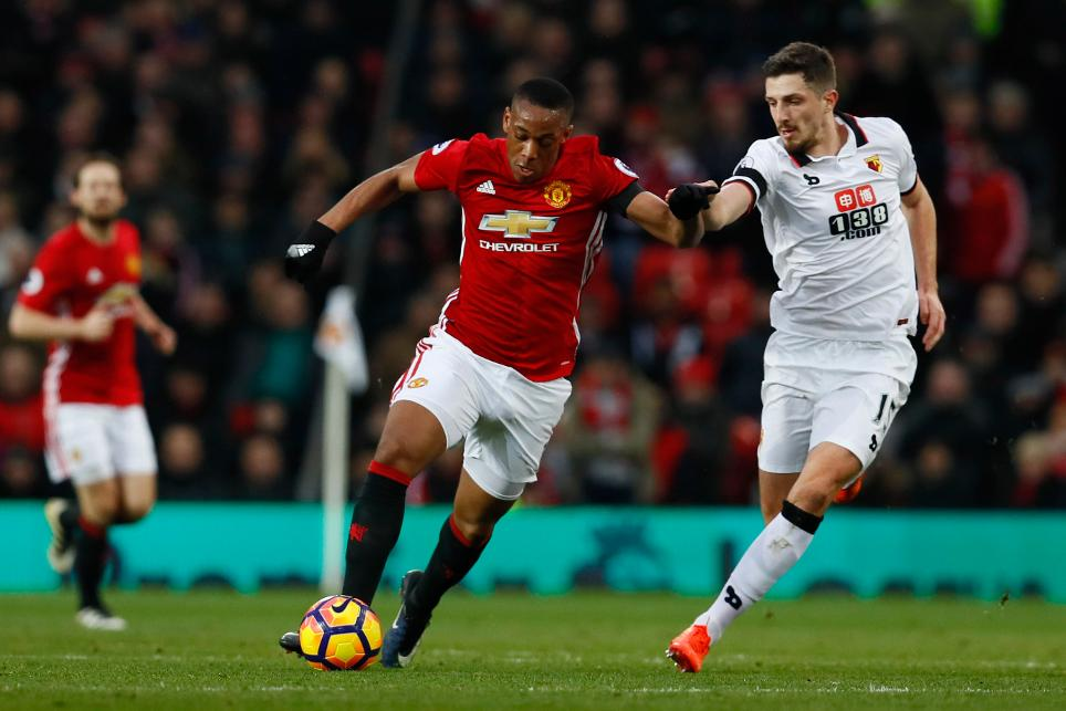 Manchester United's Anthony Martial in action with Watford's Craig Cathcart