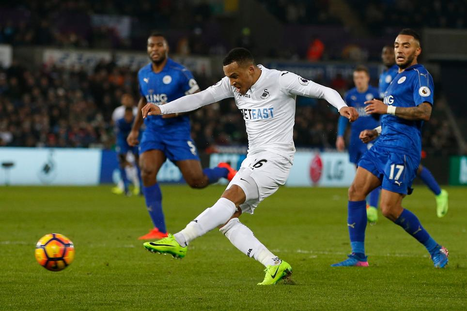 Swansea City's Martin Olsson scores their second goal