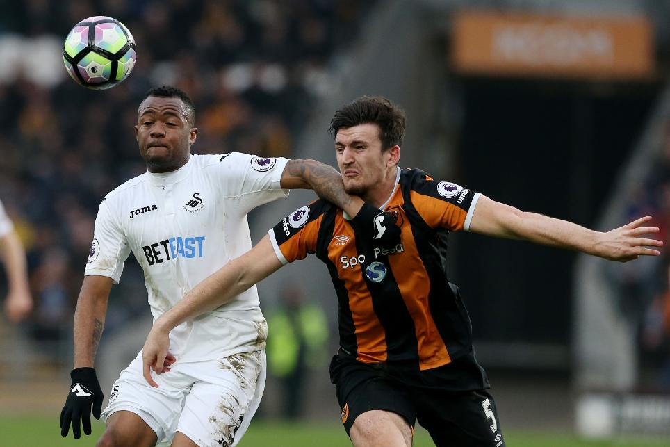 Hull City's Harry Maguire and Swansea City's Jordan Ayew