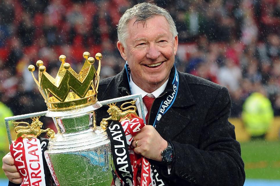 Sir Alex Ferguson holding Premier League trophy