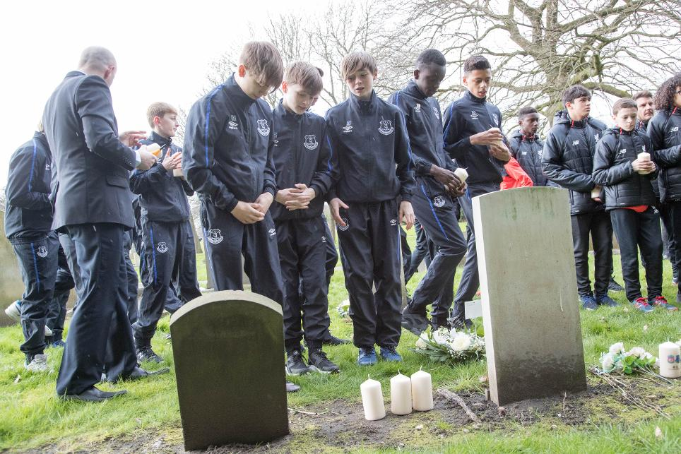 Everton and Liverpool academy players at Anfield Cemetery
