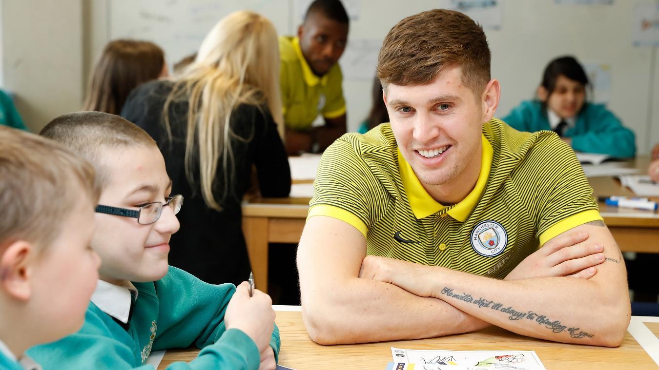 Man City stars go back to school