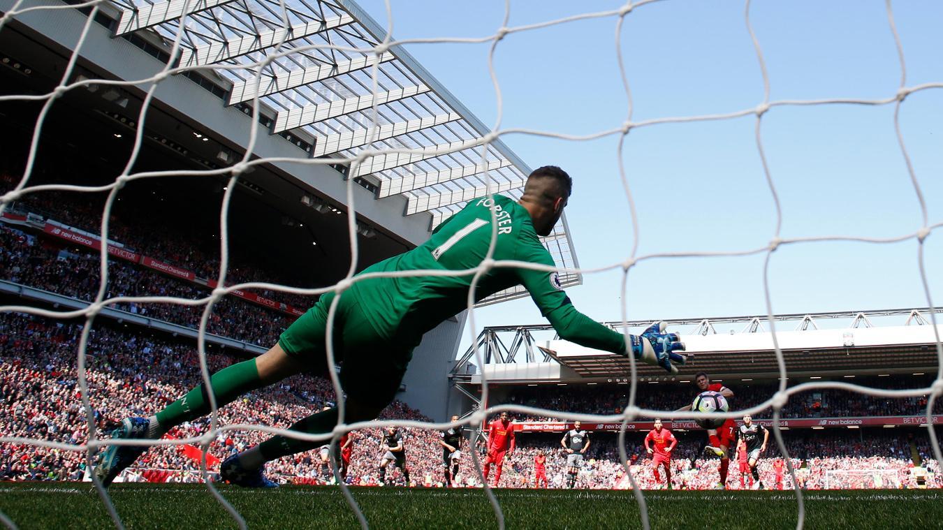 Fraser Forster saves James Milner's penalty