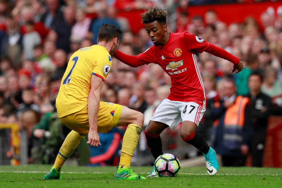 Manchester United's Angel Gomes in action with Crystal Palace's Joel Ward