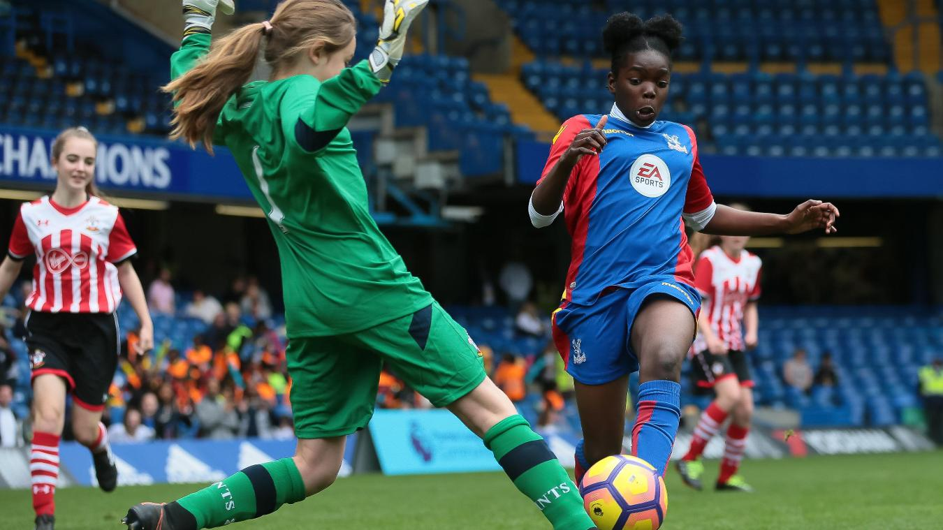 Sophie challenges for the ball at the 2017 Premier League Schools Tournament