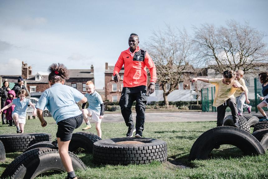 Liverpool's Sadio Mane taking part in playground activities with pupils from a primary school in Liverpool for Premier League Primary Stars