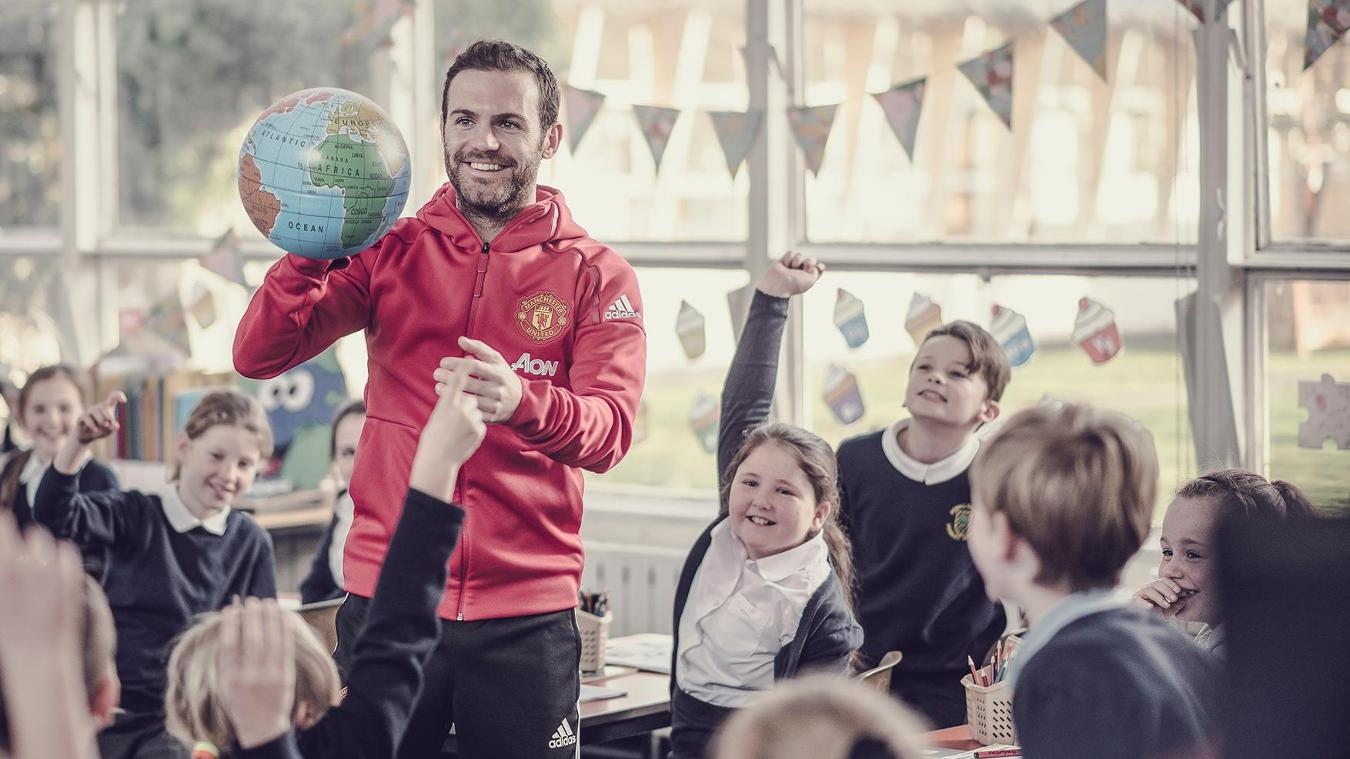 Manchester United's Juan Mata enjoys a classroom activity with local school pupils as part of Premier League Primary Stars