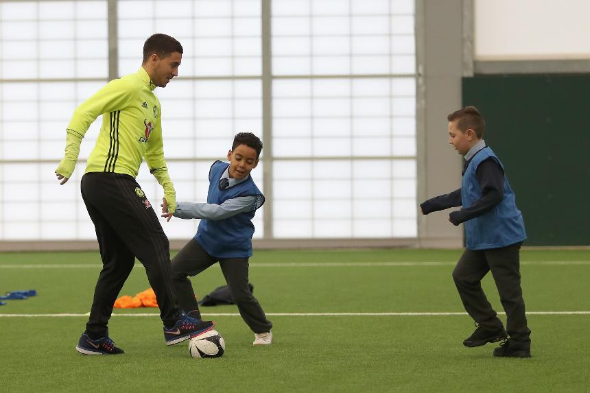 Chelsea midfielder Eden Hazard plays football with primary school pupils before picking up the Premier League Player of the Month award in November