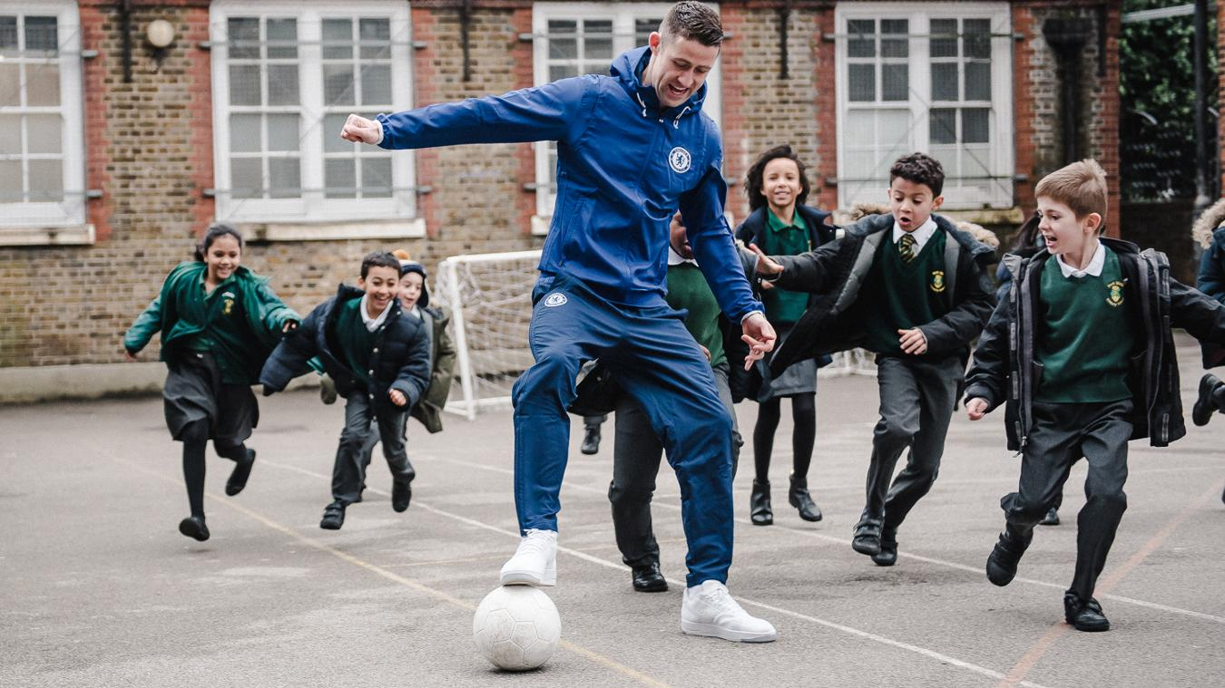 Chelsea's Gary Cahill takes part in a playground match at Park Walk Primary School for Premier League Primary Stars