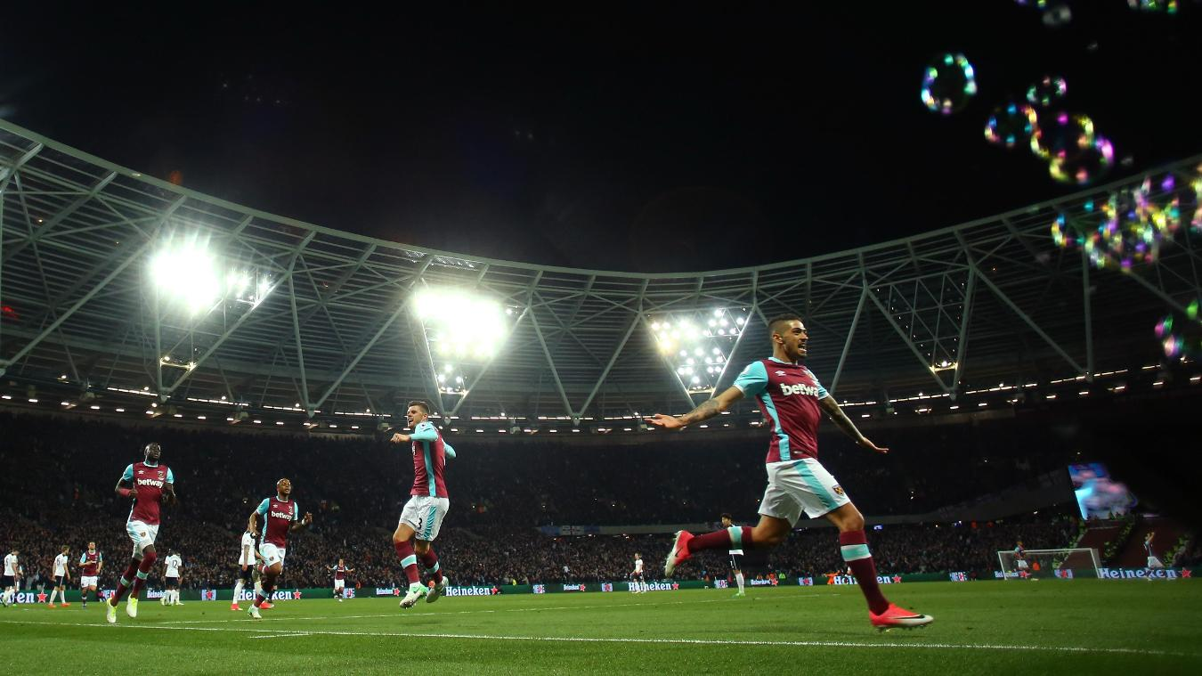 The West Ham players run away in celebration after Manuel Lanzini's finish