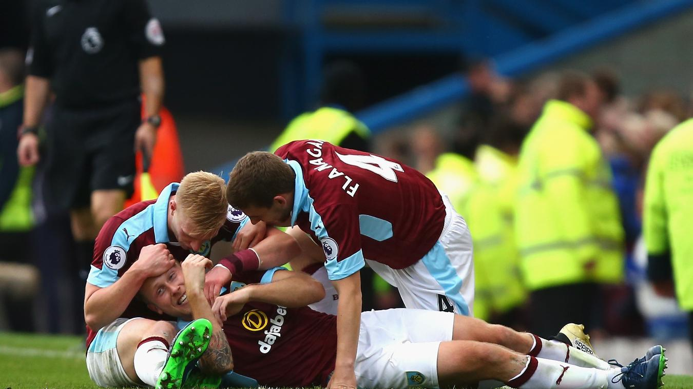 Burnley celebrating their win over the blue half of Merseyside.