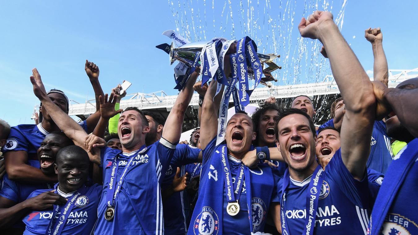 Chelsea's Gary Cahill and their club captain, John Terry, lift the Premier League trophy at Stamford Bridge