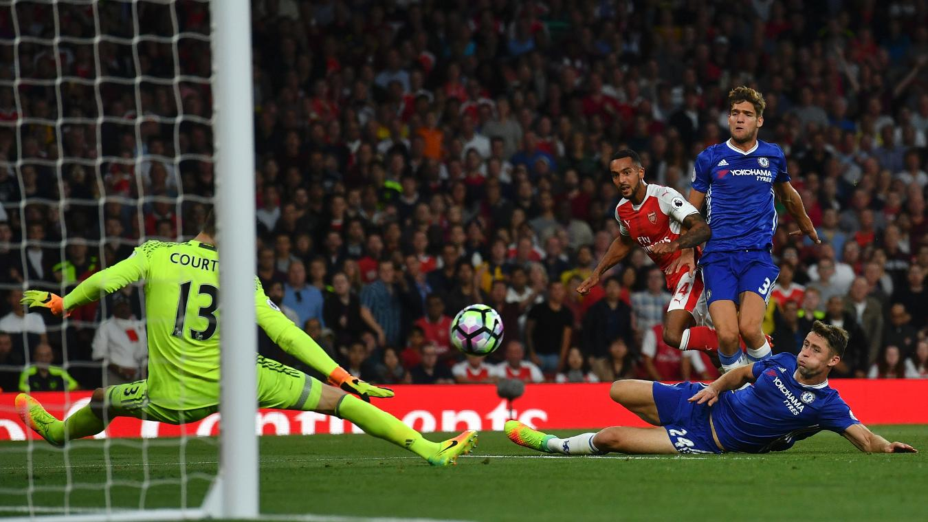 Arsenal's Theo Walcott fires an attempt on goal