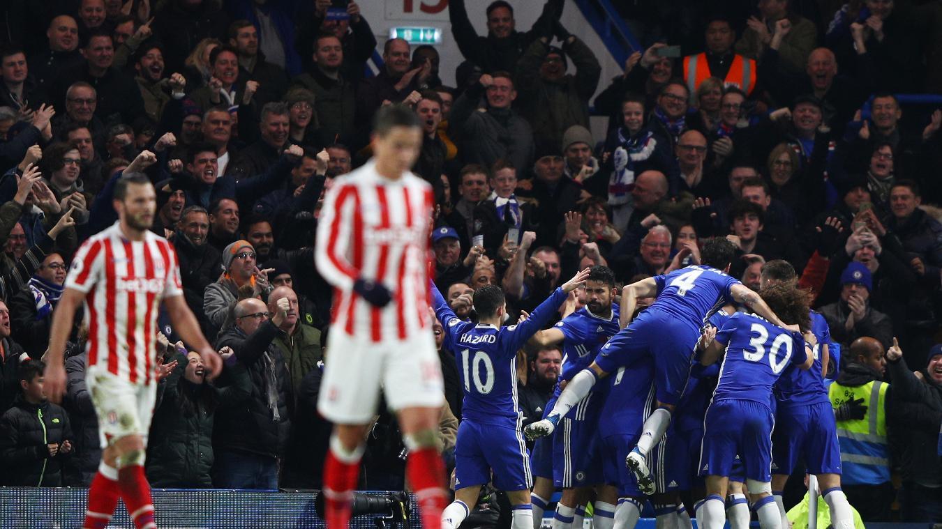 Chelsea team celebrate one of four goals versus Stoke City