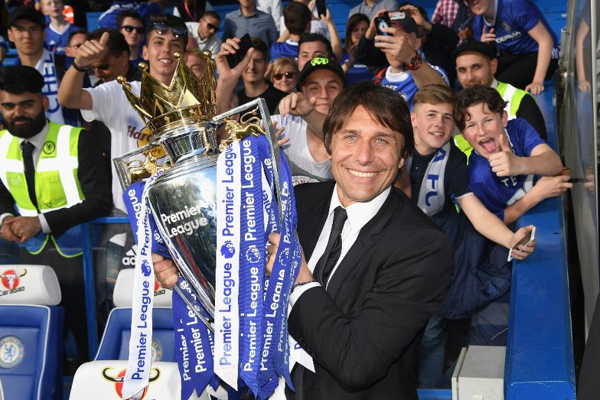 Antonio Conte is all smiles in front of the Chelsea fans after capturing the Premier League title in his first season