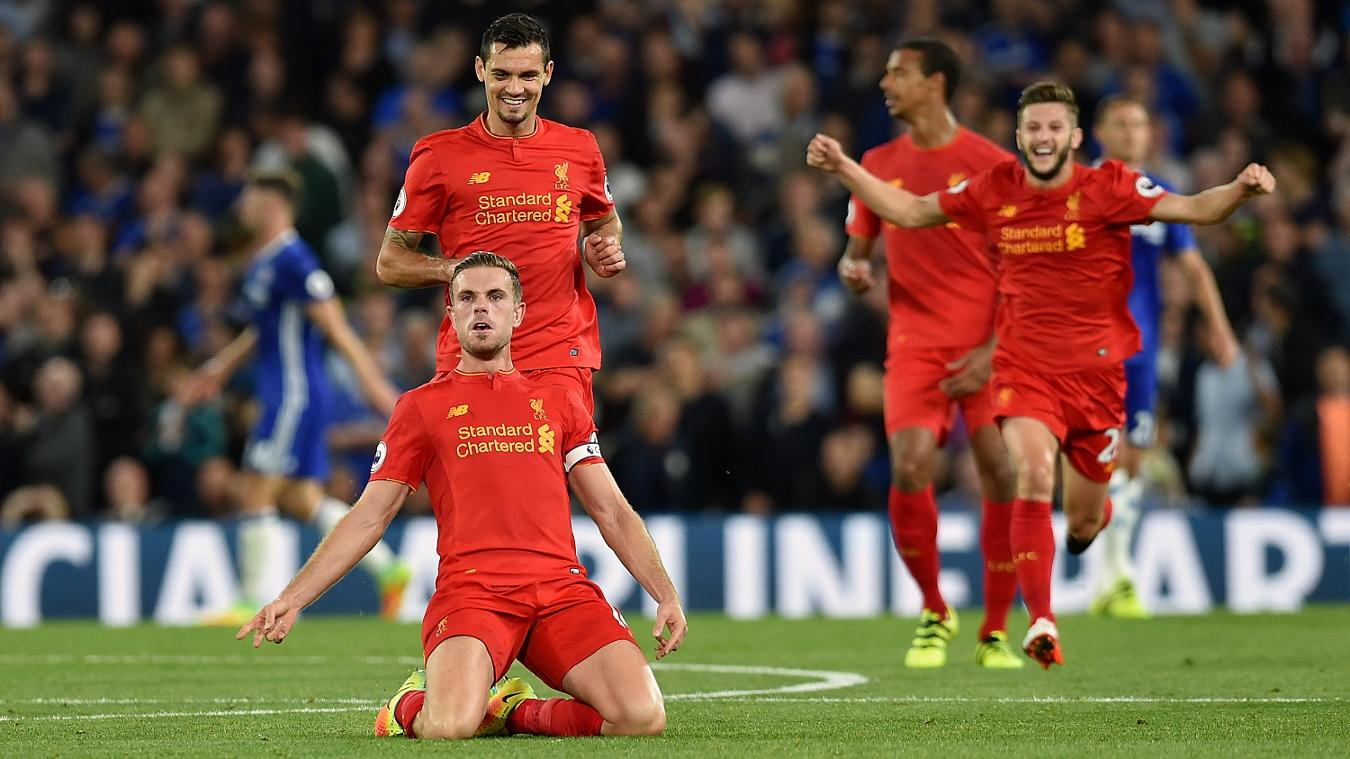 Liverpool celebrate after Jordan Henderson scores from outside the penalty area