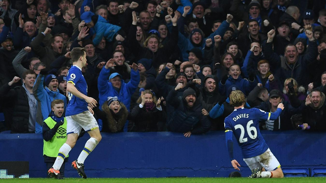 The Toffees' fans show their delight at the youngster's goal