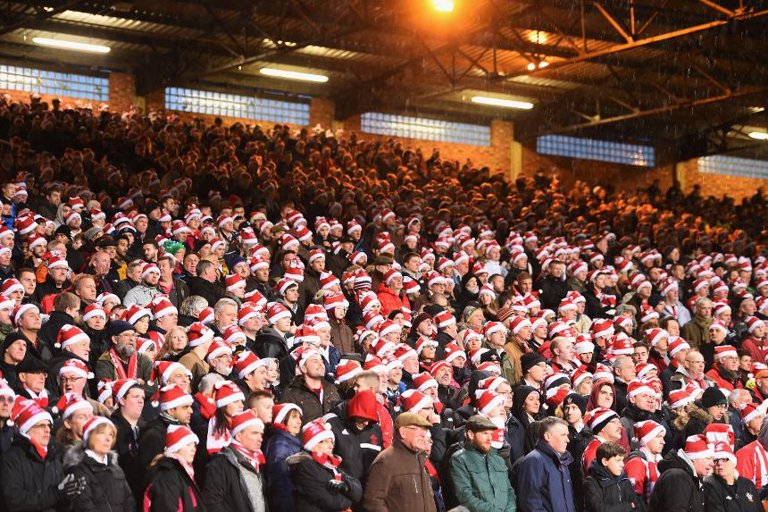 Southampton fans in Christmas hats at Crystal Palace on Boxing Day