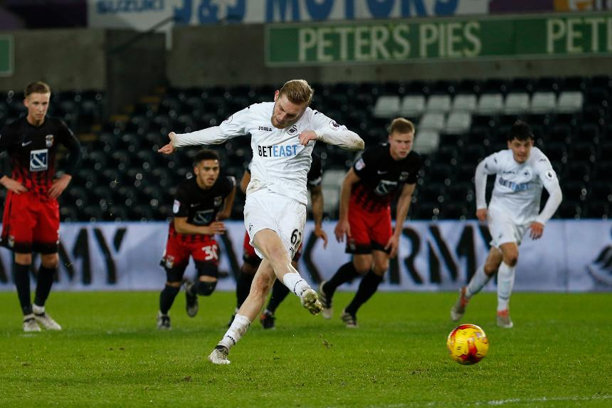Oli McBurnie scores for Swansea in the Checkatrade Trophy