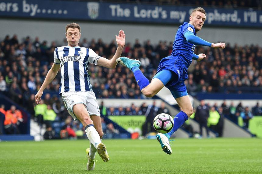 West Bromwich Albion's Jonny Evans, left, and Jamie Vardy of Leicester City