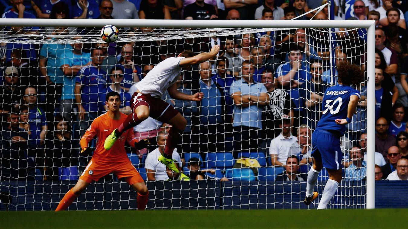 Sam Vokes heads in Burnley's third goal at Stamford Bridge