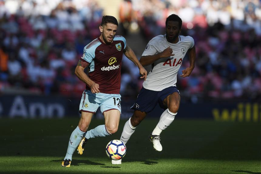 Burnley's Robbie Brady drives forward with the ball against Tottenham Hotspur