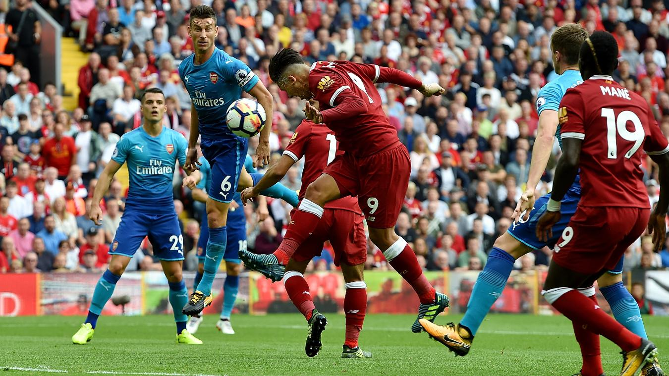 Roberto Firmino heads in Liverpool's opener against Arsenal at Anfield
