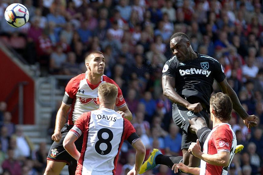 West Ham's Michail Antonio heads the ball against Southampton