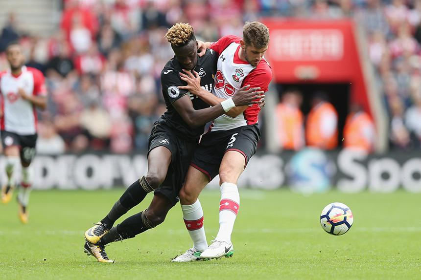 Tammy Abraham and Jack Stephens battle for the ball