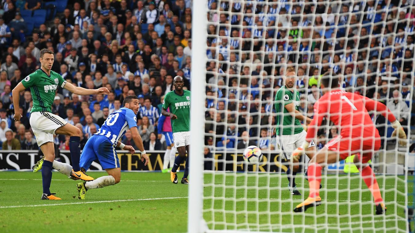 Tomer Hemed gets in front of Jonny Evans to put Brighton 3-0 up