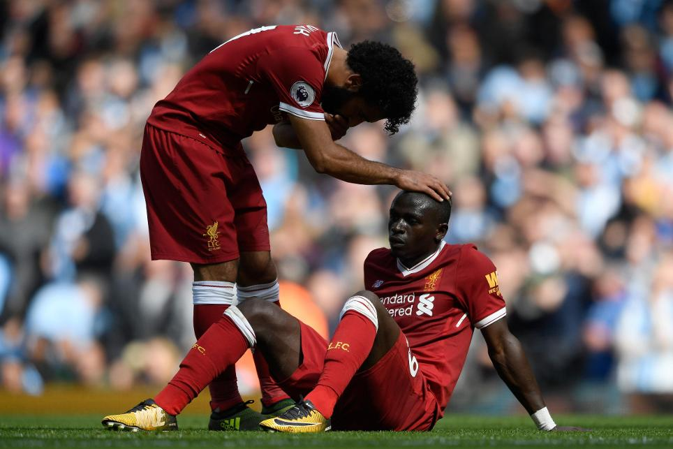 Sadio Mane is consoled by Mohamed Salah after being sent off against Manchester City