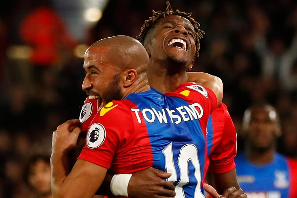 Crystal Palace's Andros Townsend celebrates scoring their first goal with Wilfried Zaha
