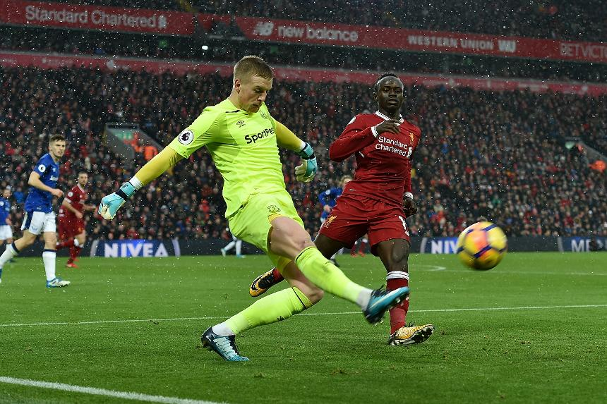 Jordan Pickford makes a clearance for Everton