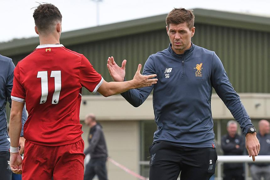 Steven Gerrard and one of his Liverpool U18 players