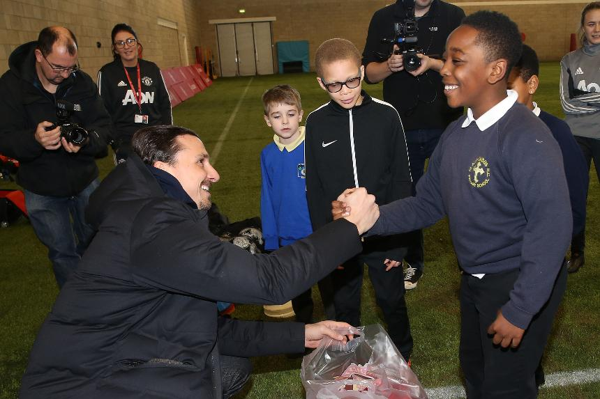 Shia from St Alphonsus RC Primary School meets Zlatan Ibrahimovic at Aon Training Complex.jpg