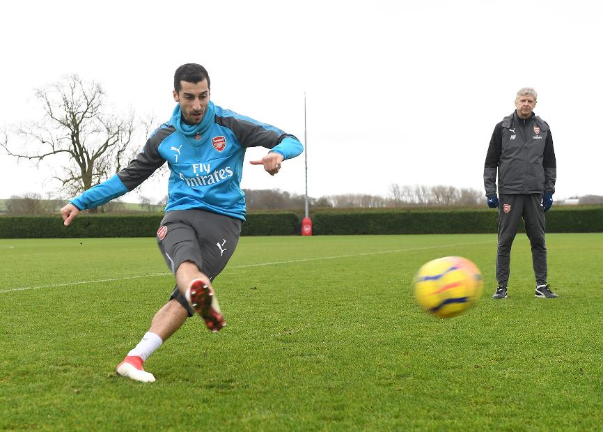 Henrikh Mkhitaryan in training, watched by Arsene Wenger